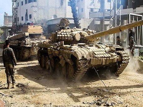 Syria tiep tuc danh bat nhom Jeish Al-Fatah ra khoi nhieu khu vuc o Aleppo - Anh 1