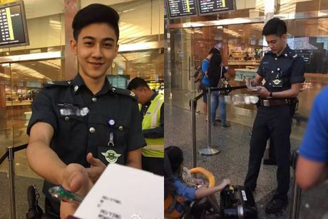 Chang canh sat dep trai, hut fan o san bay Singapore - Anh 2