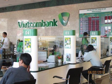 Vietcombank bao lai quy III tang gan 40%, no xau giam nhe xuong 1,75% - Anh 1