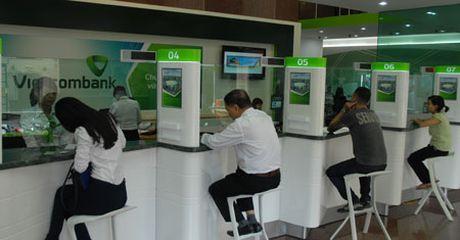 Mac su co khach hang mat tien, loi nhuan Vietcombank van tang manh - Anh 1