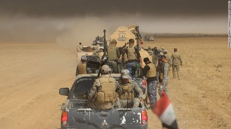 IS bat 550 gia dinh lam 'la chan song' de ngan quan doi Iraq - Anh 1