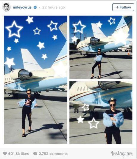 Miley Cyrus dien trang phuc quai di ung ho Hillary Clinton - Anh 2