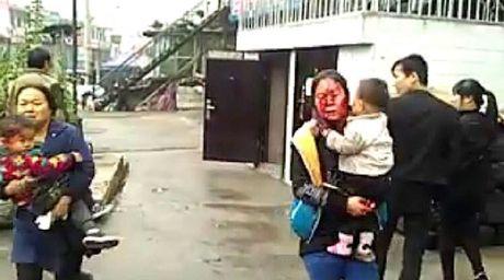 No toa nha o Trung Quoc, hang tram nguoi thuong vong - Anh 3