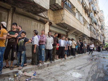 Syria to quan khung bo 'ghim' dan thuong tai Aleppo - Anh 1