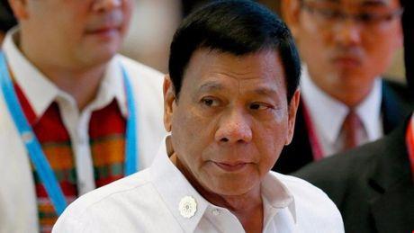 Tong thong Duterte muon uong ca phe voi canh sat can nguoi bieu tinh - Anh 1