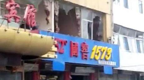 Trung Quoc: No lon pha huy hang chuc toa nha, 167 nguoi thuong vong - Anh 2