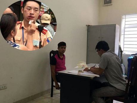 Khoi to doi tuong tan cong CSGT o nga tu Truong Chinh - Nga Tu So - Anh 1