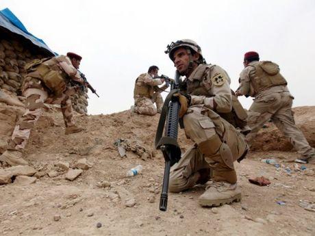 Iraq khang dinh no luc ngan chan IS tran sang Syria - Anh 1