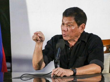 Ong Duterte am chi duoi doanh nghiep My 'khan goi ra di' - Anh 1