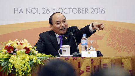 Thu tuong Nguyen Xuan Phuc lan dau chu tri hop bao quoc te - Anh 3