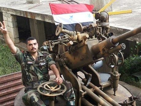 Quan doi Syria tan cong don dap phien quan o phia bac Hama - Anh 1