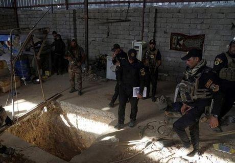 Quan doi Iraq giai phong them nhieu khu vuc gan Mosul - Anh 11