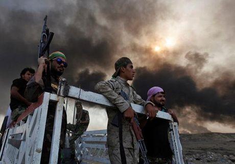 Quan doi Iraq giai phong them nhieu khu vuc gan Mosul - Anh 7