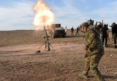 Quan doi Iraq giai phong them nhieu khu vuc gan Mosul - Anh 8