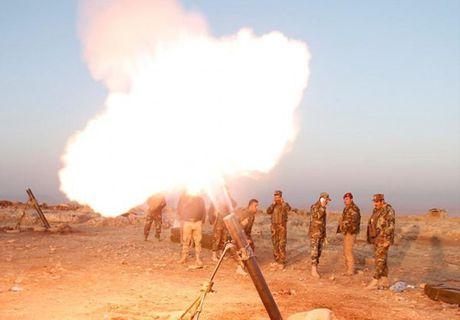 Quan doi Iraq giai phong them nhieu khu vuc gan Mosul - Anh 9