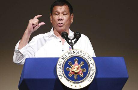 Tong thong Duterte hua se khong chui the them nua - Anh 1