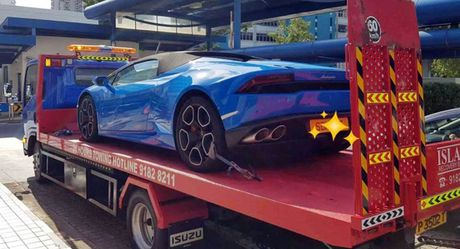 Sieu xe Lamborghini bi tam giu, tai xe bi bat vi vuot au - Anh 1