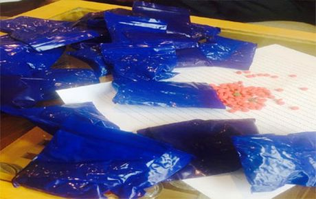 Bat vu van chuyen hon 5.500 vien hong phien - Anh 2