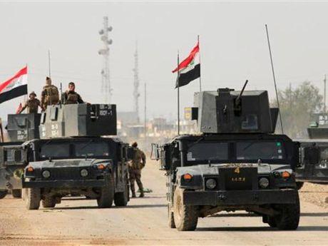 Iraq vua cat dut tuyen duong tiep te chinh cua IS tai Mosul - Anh 1