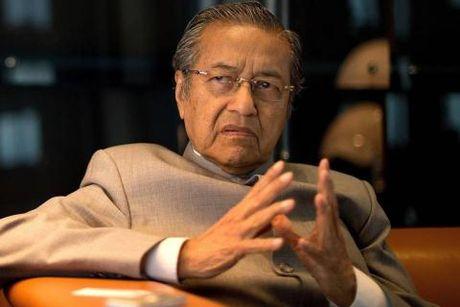 Trung Quoc dung kinh te o Malaysia: Da can duong - Anh 1