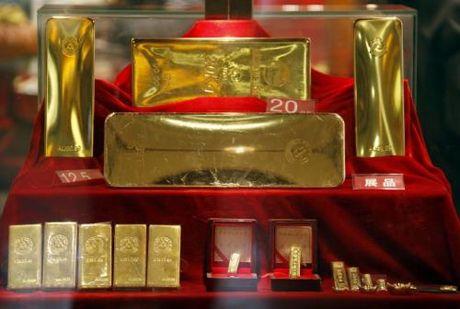 Gia vang the gioi van o tren 1.300 USD/ounce - Anh 1