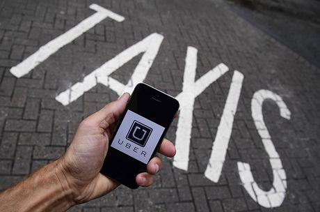 Taxi truyen thong lo ngai Uber se tao ra the doc quyen - Anh 1