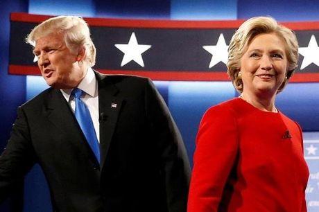 Trump va Clinton 'dau khau' ve kinh te o chang dua cuoi cung - Anh 1