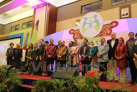 Indonesia: Tang cuong nang cao nang luc phu nu, bao ve tre em - Anh 1