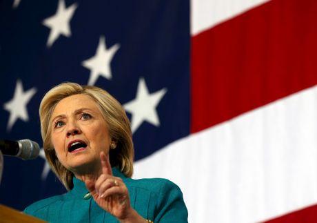 Hillary Clinton va Donald Trump, hai thai cuc doi lap ve chinh sach - Anh 3