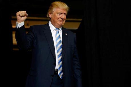 Ong Trump va ba Clinton chay dua van dong gio chot truoc bau cu - Anh 13