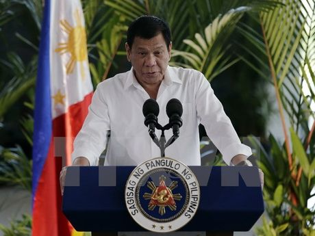 Tong thong Philippines tham Malaysia ban ve an ninh hang hai - Anh 1