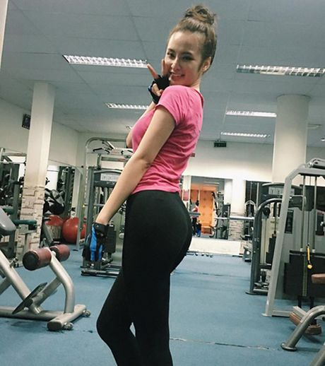 Hot girl Viet 'sexy muon phan' trong phong tap gym - Anh 14