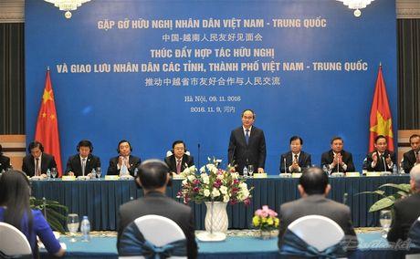 Thuc day hop tac huu nghi va giao luu nhan dan Viet-Trung - Anh 6