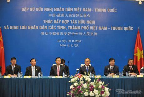 Thuc day hop tac huu nghi va giao luu nhan dan Viet-Trung - Anh 7