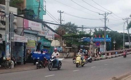 Quan 7, TP. Ho Chi Minh: Doanh nghiep 'kho tho' vi cach quan ly cua phuong - Anh 3
