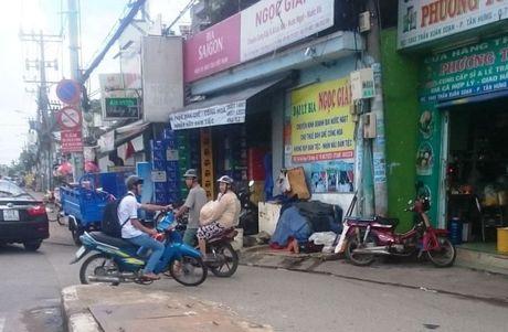 Quan 7, TP. Ho Chi Minh: Doanh nghiep 'kho tho' vi cach quan ly cua phuong - Anh 4
