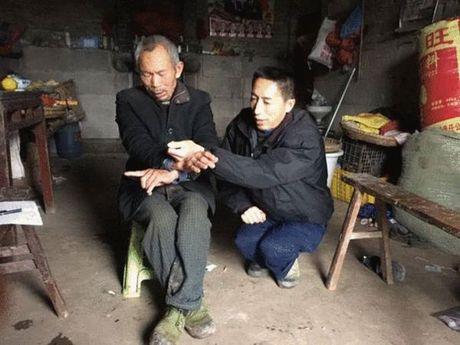 Trung Quoc: Di kien, cu ong bi bat ve danh chet - Anh 1