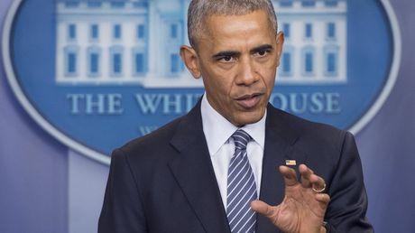 Obama am chi ba Clinton khong van dong tich cuc nhu ong - Anh 1
