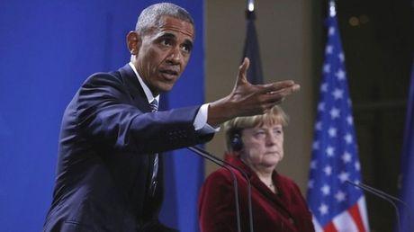 Tong thong Obama keu goi ong Trump chong Nga - Anh 1