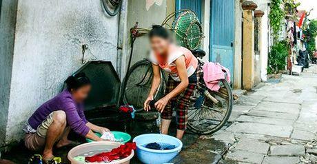 Nguoi dan sap phai dong phi xa nuoc thai - Anh 1