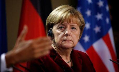 Obama, Merkel de nghi Trump cung ran voi Nga - Anh 2