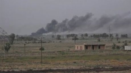 IS chong tra dien cuong o chien truong Mosul - Anh 1