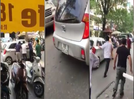 Ha Noi: Vi pham giao thong, dam thang xe vao CSGT bo chay - Anh 1