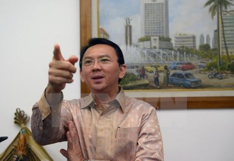 Canh sat tham van thi truong Jakarta ve cao buoc phi bang dao Hoi - Anh 1