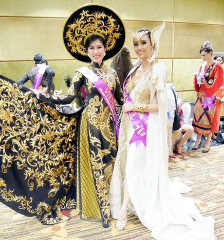 Emily Hong Nhung lot top 9 Hoa hau Du lich Quoc te - Anh 1