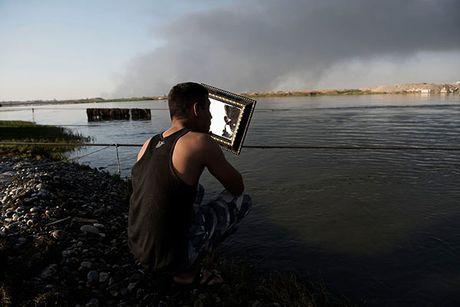 Noi kinh hoang cua dan ti nan chay khoi Mosul - Anh 9