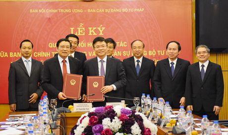 Ban Noi chinh Trung uong va Bo Tu phap ky Quy che phoi hop cong tac - Anh 1