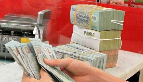 USD len sat 23.000 dong: Canh bao dao chieu, coi chung ho nang - Anh 1