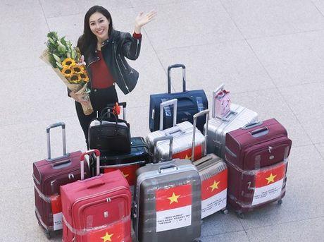 Hoa khoi Dieu Ngoc mang 100kg hanh ly di thi Miss World - Anh 1