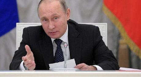 Putin canh bao sa thai quan chuc cap cao lam them ngoai gio - Anh 1